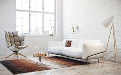 sofa armchair coffee table floor lamp rug painting window