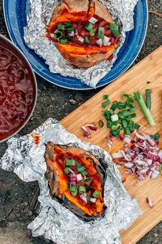 These campfire foil sweet potatoes stuffed with chili are a hearty camping meal. Camping Food | Camping Meals | Camping ideas