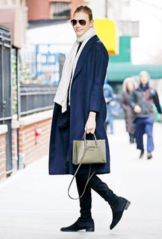 Karlie Kloss all bundled up in a scarf, coat, and chic over-the-knee boots