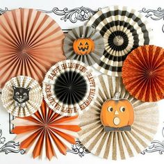 """These Halloween rosettes will look great at your halloween party! Includes all 8 rosettes pictured. 2 - 17"""", 2 - 14"""", 2 - 11"""" and 2 - 8"""" fans with 3 fan face-plates"""