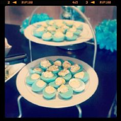 Baby boy shower. Blue deviled eggs. Hard boil, peel, half, scoop out yoke, place white halves in bowl of water and food coloring until desired color is reached, let dry on paper towel then fill with mixture!