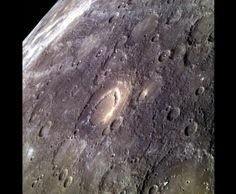 4/24/2014: MESSENGER space-craft in orbit around Mercury obtained this image of the peak-ring basin Scarlatti (center) on 3/30/2014. Scarlatti has a ring of peaks at its center, typical in many respects, although in the NE sec-tion, it transitions to a large (approx.19 mi) pit surrounded by high-reflectance material. Past explosive volcanic activity may have created this pit. Tom Chao