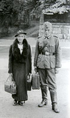 German soldier is photographed with his elderly mother before departing for the front in the West in Sept 1940. This was before Barbarossa. Most likely, this young man, like millions of others, ended up fighting, and perhaps dying, on the Eastern Front.