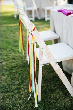 Ribbons on your chairs can bring in your color palette without using full chair covers - plus it looks very festive!