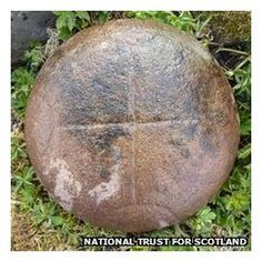 """A stone discovered by chance on the Isle of Canna is Scotland's first known example of a bullaun """"cursing stone"""", experts have revealed.    Dating from about 800 AD, the stones are associated with early Christian crosses - of which there is one on the isle."""
