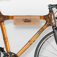 Wall-mounted bike storage solution #bamboo #leather #bike #bikeshelf #wallbracket