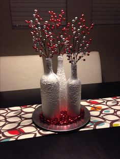 Table centerpiece for the holidays...spray paint wine bottles white and cover them in epsom salt using spray adhesive!