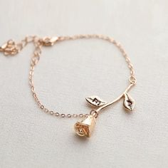 -handmade item -material: gold plated, silver plated, and rose gold plated -initial stamped on leaves -made to order - processing takes 2-4 days -The bracelet