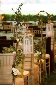 #Woodland #weddings can be complimented with an aisle of these lanterns on shepherds hooks. Twist some branches from a rose bunch (including some of the foliage) around the hooks to enhance your theme.