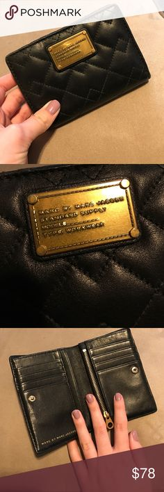 Marc by Marc Jacobs wallet Lightly used black leather Marc by Marc Jacobs wallet. Has several credit car slots and convenient change holder with zipper inside. Some wear around the edges but not noticeable. In good condition. Super cute and small to fit in a satchel or smaller purse and a great pair for really any bag! Marc by Marc Jacobs Bags Wallets