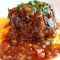 "Osso Bucco, in Italian means""Bone with a Hole"". Veal shanks, or Oxtail is seared and then braised in a sauce with red wine, herbs and beef stock. The meat is super tender, and is traditionally served over Risotto. Plan on a few hours of cooking it low and slow. This is a delicious dish, that can be pricey in a restaurant. On my food blog, I show you how to make it yourself."