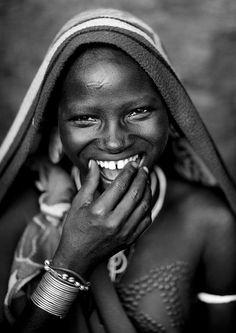 Africa | Surma girl laughing, Kibish, Ethiopia | © Eric Lafforgue