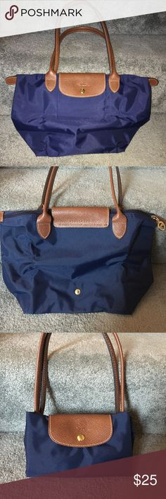 Longchamp Le Pliage Small Nylon Tote Small nylon authentic Longchamp tote in Navy blue. Some minor noticeable wear on bottom corners. Longchamp Bags Totes