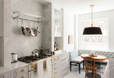 BECKI OWENS - Marble, gray and brass #kitchen. Sharing details of this beautiful space today on the blog. Via Fox Force Five Construction.