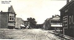 Upper Alton in 1909, at the corner of Washington and College Avenue, with the W. A. Clark Drugstore on the far right.