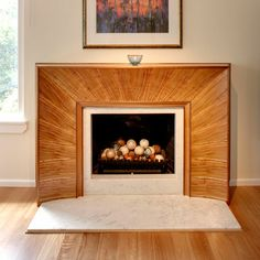 The fireplace surround is one of Rolf's finer pieces. The design was technically difficult and required a high degree of precision on large ...