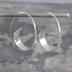 Classic and unique, these handmade sterling silver curl hoop earrings have a unique ribbon-like modern aesthetic- a statement jewelry to make part of your collection.Can also choose Sterling silver gold plated. All Otis Jaxon pieces will be beautiful Sterling Silver Hoops, Handmade Sterling Silver, Silver Necklaces, Sterling Silver Earrings, Gold Jewelry, Jewelery, 925 Silver, Handmade Silver Jewelry, Statement Jewelry