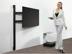 The TV holder solution by Wissmann is a minimalist wall construction, with which the flat scr Tv Stand Room Divider, Tv Stand Decor, Grey Living Room With Color, Living Room Accents, Tv Unit Furniture, Furniture Design, Tv Holder, Best Tv Wall Mount, Swivel Tv Stand