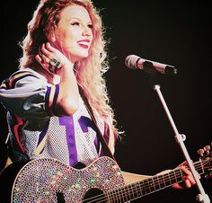 meet taylor swift. <3 <3 or at least see her live.