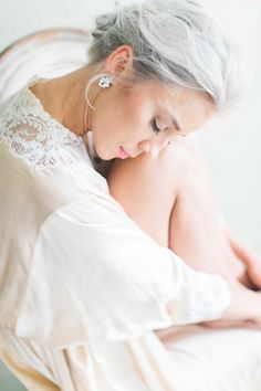 Indoor Wedding Ideas in a Smokey Grey as seen on Wedding Sparrow. On model: our Navette Crystal Studs by Erin Cole.