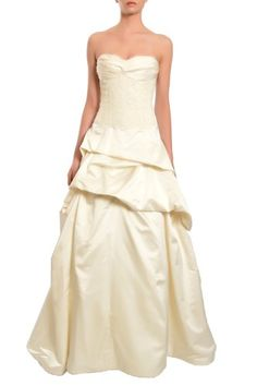 """Ivory, Devine strapless ivory wedding gown has bustier style lace bodice with sweetheart neckline and button detail back. Full skirt with """"take-up"""" design and chapel length train with lace insert. Crinoline and boning in lining. Back zipper/Button"""