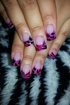 Pink and purple colored acrylic nails