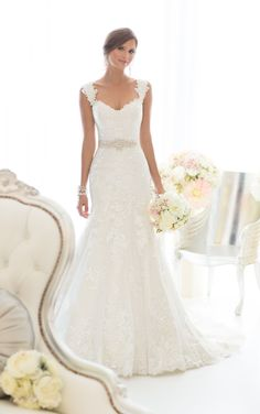 Beautiful all-over Lace fit and flare wedding dresses feature Diamante beading throughout and romantic cap sleeves. Exclusive designer wedding dresses by Essense of Australia.