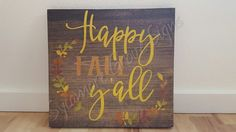This beautiful sign serves as the perfect way to celebrate the beauty of Fall! Hang it in your hallway, dining room, or gallery wall for a meaningful finishing touch. The stained and painted design will look perfect with about any decor.  Sign Details:  * Measures approximately 12 tall by 12 wide by 1 deep  * 100% handmade and hand-painted  * Quote: Happy FALL Yall  * Comes with unattached saw-tooth hanger  * This is a PRE-MADE sign and is available to ship in 1-3 BUSINESS DAYS  * My…