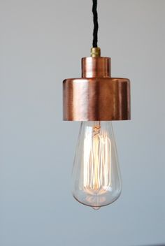 Pendant, or hanging lamp with Edison-style bulb and copper fitting Copper Hanging Lights, Copper Lighting, Home Lighting, Lighting Design, Pendant Lights, Kitchen Lighting, Lighting Ideas, Copper Ceiling, Copper Lamps
