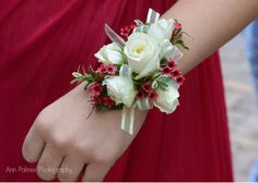 FREE HOMECOMING FLOWER TUTORIALS http://www.wedding-flowers-and-reception-ideas.com/make-your-own-wedding.html Learn how to make corsages and matching boutonnieres. Buy corsage bracelets, flower jewels, floral supplies and more. Dainty white sweetheart roses accented with hot pink wax flower and variegated miniature leaves.