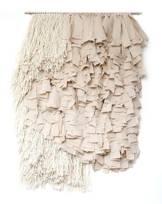 """hand knotted wall hanging  19"""" W by 25"""" H  bleached linen backing  strung on 18"""" brass rod  silk, wool"""