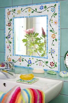 What a cute mirror idea.... cut plywood to size; prime, paint and stencil.