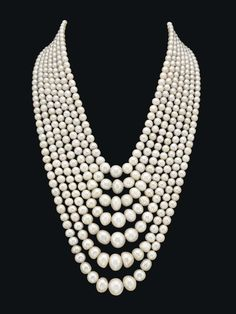 The seven strands composed of seventy-five, seventy-six, eighty-one, eighty-seven, ninety-one, one hundred, and one hundred and four graduated round to button-shaped natural pearls,