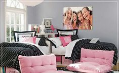 black, white, and pink bedding with gray walls