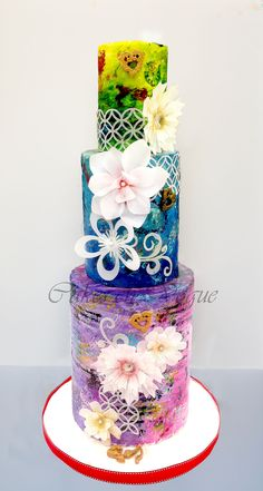 """Vintage Fantasy - My Vintage Theme Cake with Fantasy flowers! I love Old unique styles. I have mix matched several elements and tried to create a textured effect, with mix of colors, tie and dye effect, all handpainted. Wanted to add few more finishes to it, but time did not permit me. When people generally say , it's so off season, I say, """"It's Vintage! """"  I call these flowers Fantasy,  quite different from the usual edible natural flowers you see.  I tried to use my own imagination to ..."""