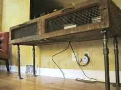 Tv/entertainment stand or cabinet w/storage (reclaimed barnwood and black pipe). $329.99, via Etsy.