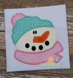 Snowman Face Applique - This cute and fun Snowman Design is perfect for both boys and girls. Use him all winter long or add Christmas fabric and bells for a perfect Holiday project. Get the matching Faux Smock design