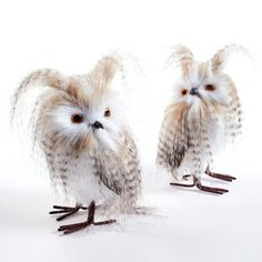 Make our Long-eared Owls the hoot of your holiday decor. Adorn the boughs of your tree, or make these wise birds the stars of a woodland mantel scene. Downy ear tufts and mottled faux feathers frame their wide eyes, solid-foam bodies, and realistic claws, to make each pair a dynamic duo of wintertime wonder. Set of two wide-eyed owlsDetailed with downy ear tufts, mottled faux feathers, and realistic metal clawsCrafted on a foam baseEach set includes one right-facing and one left-facing owl