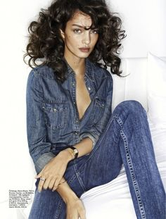 .Denim shirt, jeans-not usually a fan of this combination, but she wears it well. Wish I knew the model. She is gorgeous.