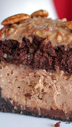 This dessert is pretty much a double chocolate cheesecake topped with a modest layer of German chocolate cake. And no, we're definitely not complaining. Get the recipe from Willow Bird Baking. Cheesecake Desserts, Just Desserts, Delicious Desserts, Dessert Recipes, Health Desserts, German Chocolate Cheesecake, Chocolate Desserts, Chocolate Cake, Chocolate Moose