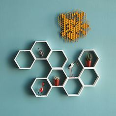 These would make wicked cute display shelves! Look what I found at UncommonGoods: Honeycomb Decorative Accent Shelf