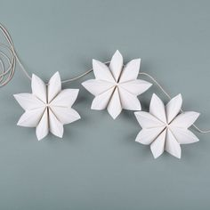 Paper flower garland Here are instructions on how to make a festive garland to brighten up your day. You will need: gram paper, cutting tool, cutting mat, stapler, awl and some string. H… Paper flower garland Here are instruct Flower Garland Wedding, Paper Flower Garlands, Flower Paper, Origami Flowers, Diy And Crafts, Crafts For Kids, Paper Crafts, 1st Grade Crafts, Newspaper Flowers