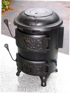 Old style wood heater. And you can cook on top.