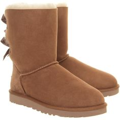 UGG Australia Bailey Bow Calf Boots ($275) ❤ liked on Polyvore featuring shoes, boots, ankle booties, uggs, short booties, bootie boots, bow ankle boots, embellished boots and ankle boots