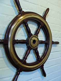 Exceptional 30 inch classic-designed six-spoke mahogany yacht wheel from the late 19th or early 20th century. This beautiful old wheel features classic ring-and-urn turned spokes, thick cast brass rings on both sides with solid brass hub. #skipjack #nautical #shipswheel #coastal #authentic #antique
