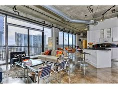 High-end Downtown Austin condo. According to Zillow, the median price Downtown is Austin Homes, Austin Texas, Austin Home Search, Barn Renovation, Pole Barn Homes, Concrete Floors, Viera, Home Remodeling, Building A House
