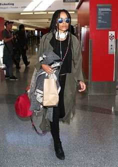 Zoe Kravitz didn't forget her must-have accessory: headphones