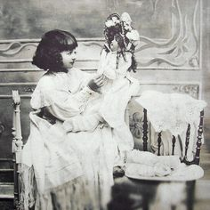 Girl with doll antique photo postcard 1900s