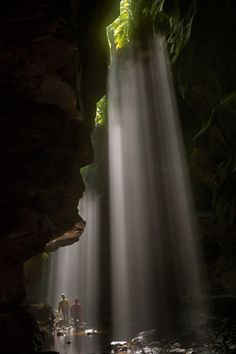Midday shafts of light intensify the cathedral-like atmosphere of Rocky Creek Canyon. (Photograph by Carsten Peter)