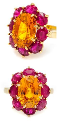I love the colors in this ring! It's a 6.68 carat orange sapphire with 4 carats of rubies.